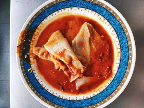 Roti canai banger with spicy chicken curry